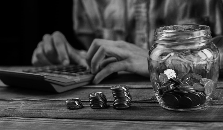 man-calculating-monthly-savings-min